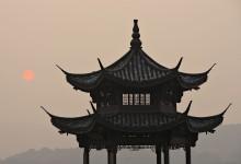 pavilion at sunset of west lake of hangzhou, china